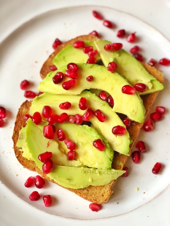 Winter Breakfast Idea! Simple Healthy Avocado Toast Breakfast Recipe made with pomegranate seeds! This is also delicious for lunch or a mid day snack. Healthy pomegranate recipe. Perfect for Christmas and holidays! Even the kids will love this. Instrupix.com