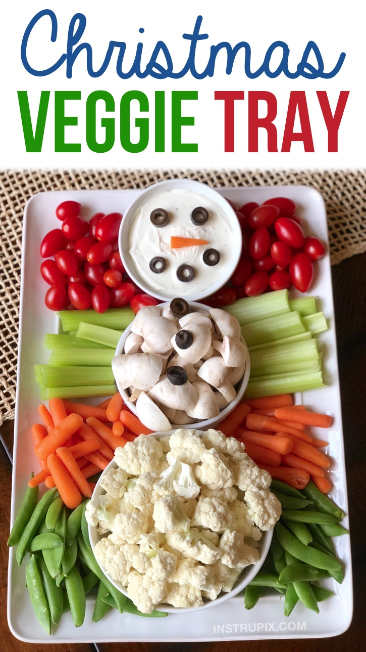 Christmas veggie tray idea for holiday parties! Check out this super fun and cute snowman vegetable tray. It's so simple to make and the kids and adults will love this healthy finger food appetizer idea! Perfect for a crowd or large family gathering. Make ahead, no bake, easy, healthy and super fun! #christmas #holidays #appetizers #veggietray #instrupix