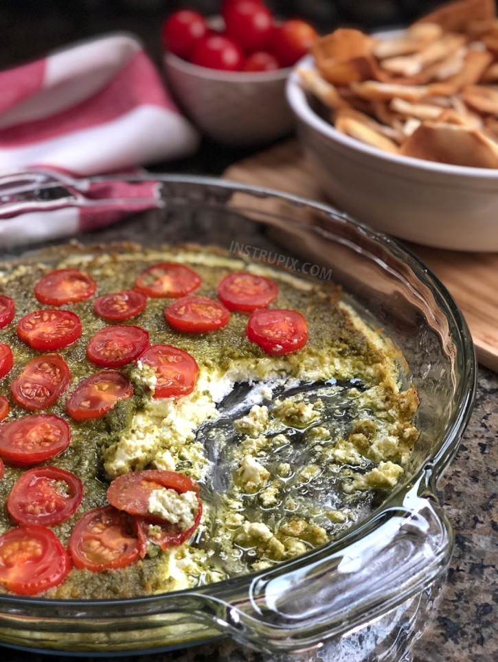Warm Caprese Cheese Dip Recipe - This easy appetizer dip for a party is a real crowd pleaser! Just 3 ingredients! It's perfect served with pita chips, bread or crackers. | #instrupix #appetizers #diprecipes #partyfood #caprese #basilpesto #creamcheese