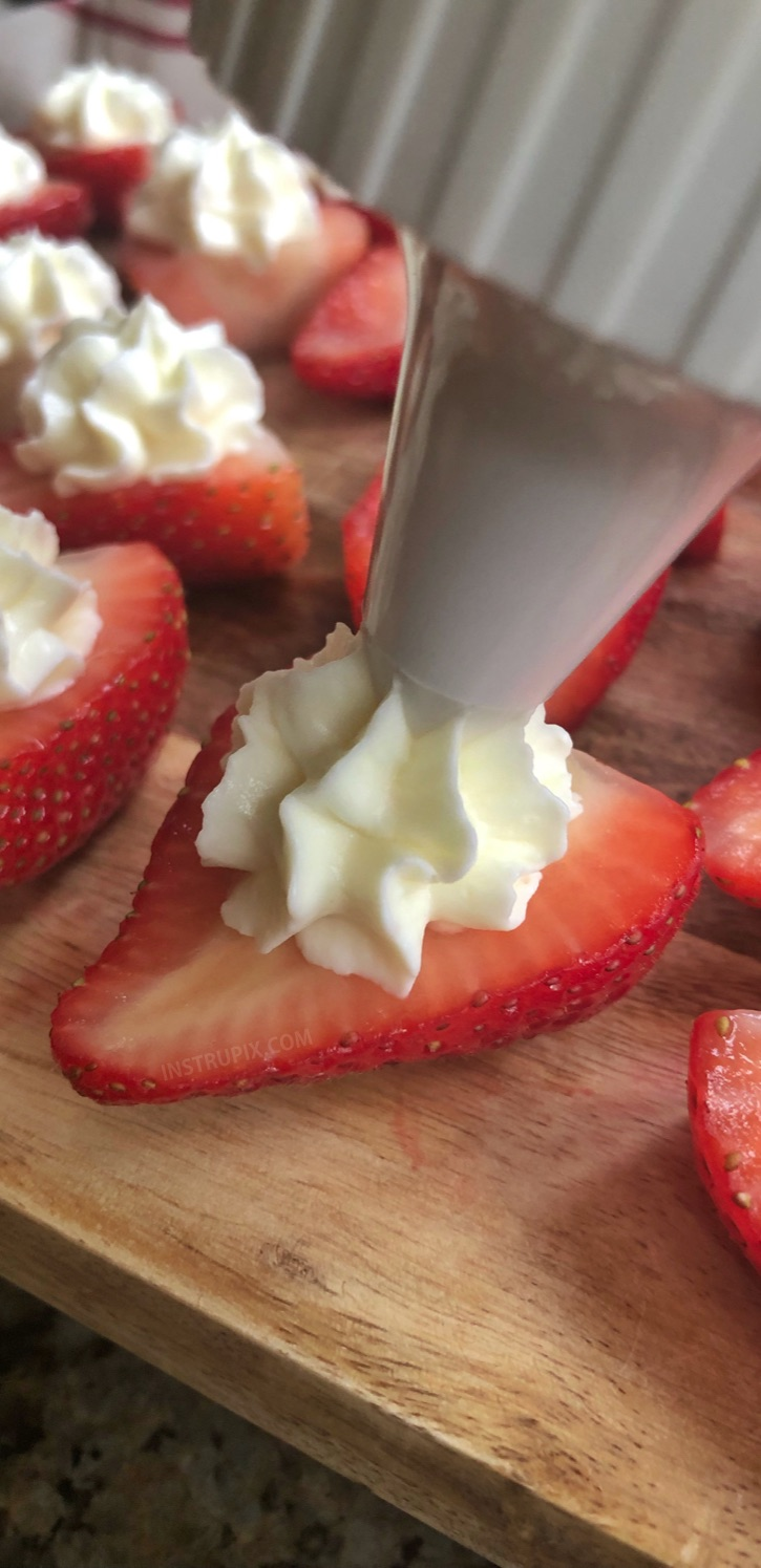 Deviled Strawberries Recipe (made with a sweet cream cheese filling) - The BEST finger food, sweet snack and party idea for a crowd! This quick, easy and fun appetizer idea is also perfect for Valentine's Day! Kids and adults love them. #instrupix #partyfood #strawberries #cheesecake #creamcheese #valentinesday #dessert #sweettooth