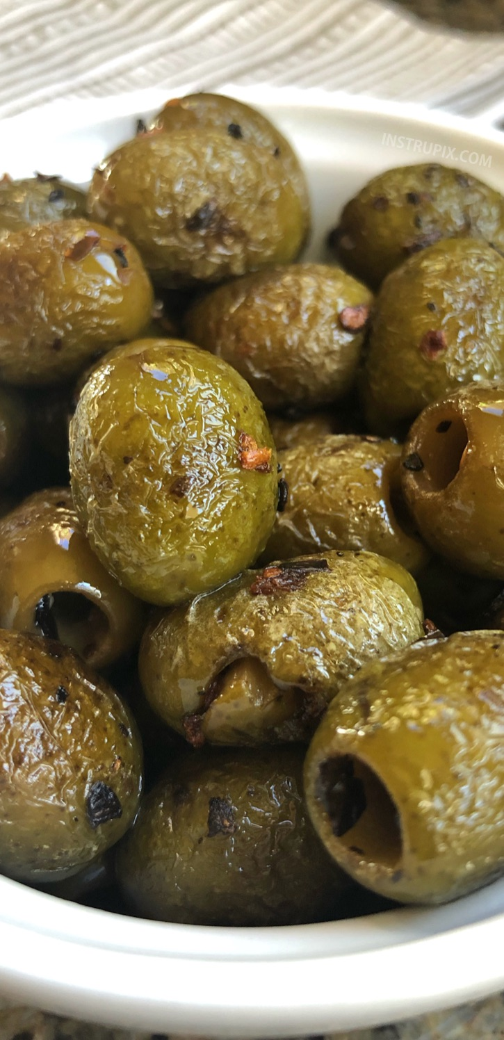 Blistered Green Olives Recipe - This easy low carb snack idea is perfect for on the go! They are also the most delightful little keto party snacks to accompany a cheese board. | Instrupix #keto #lowcarb #greenolives #instrupix