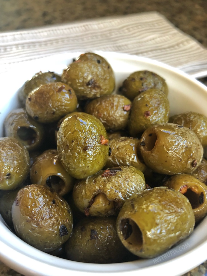 Blistered Green Olives - YUM! This easy low carb snack idea is perfect for on the go! They are also the most savory little keto party snacks to accompany a cheese board. | Instrupix #keto #lowcarb #greenolives #instrupix