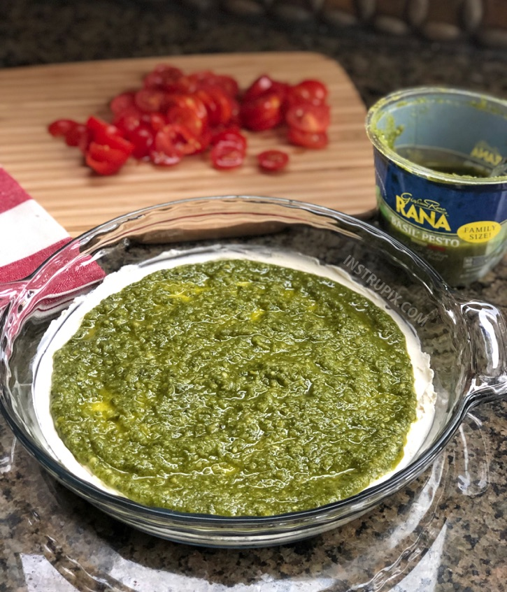 Easy 3 Ingredient Warm Caprese Dip Recipe - This easy appetizer dip for a party is a real crowd pleaser! Made with cream cheese, basil pesto and tomatoes. It's perfect served with pita chips, bread or crackers. | #instrupix #appetizers #diprecipes #partyfood #caprese #basilpesto #creamcheese