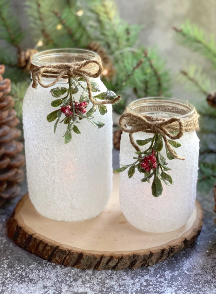 If you are looking for easy Christmas projects to make, these DIY Snowy Mason Jars are a fabulous gift idea! This easy holiday craft is perfect for adults but also easy enough for kids. It's quick, simple, and cheap yet a stunning home decor idea for Christmas! I like to use these DIY mason jar tea light holders as a centerpiece on my dining room table. #instrupix #christmas #masonjars