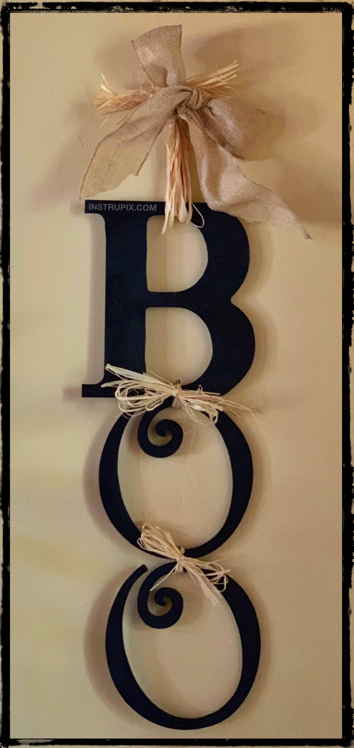 Looking for easy DIY Halloween decoration ideas? This easy Boo sign is super fun to hang on your front door or by your entryway. It's great for inside or outside, hang it wherever you want! This homemade Halloween decor is simple, cheap and fun to make! #halloween #instrupix