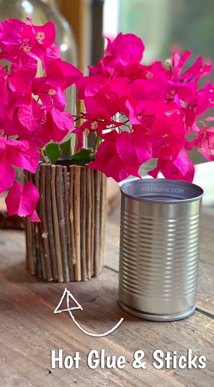 DIY Rustic Vase made out of a tin can! Looking for easy upcycling projects? There are so many ways to dress up a tin can! This cheap and easy craft is great for kids and adults! Simply use sticks and hot glue to cover a tin can. #upcycling #recycling #easycrafts #instrupix