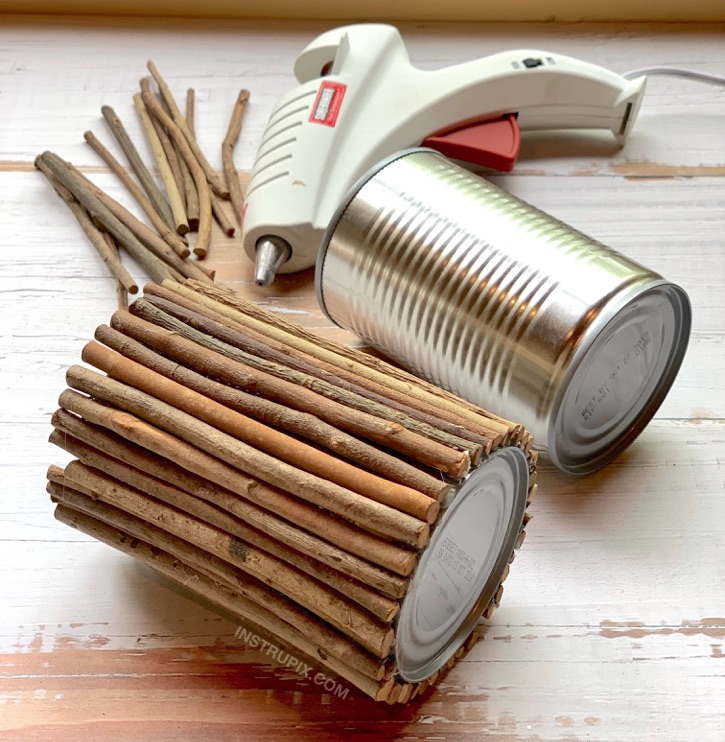 DIY Tin Can Makeover -- using sticks and hot glue! 6 Charming Ways To Dress Up A Tin Can