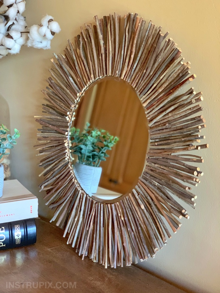 DIY Stick Framed Round Mirror -- made with cardboard and hot glue. Cheap and easy!