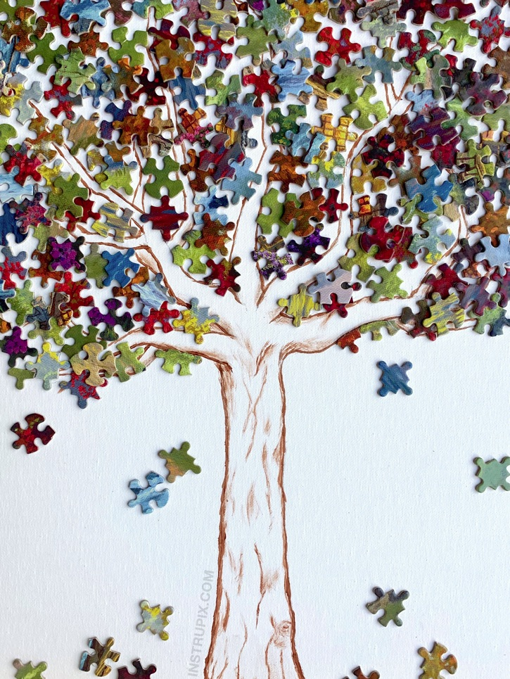 Fun & Creative Puzzle Piece Craft Ideas -- This puzzle piece tree is awesome DIY wall decor for teenagers and adults to make! It's a fun and simple recycling project and stress reliever. #instrupix #craftideas