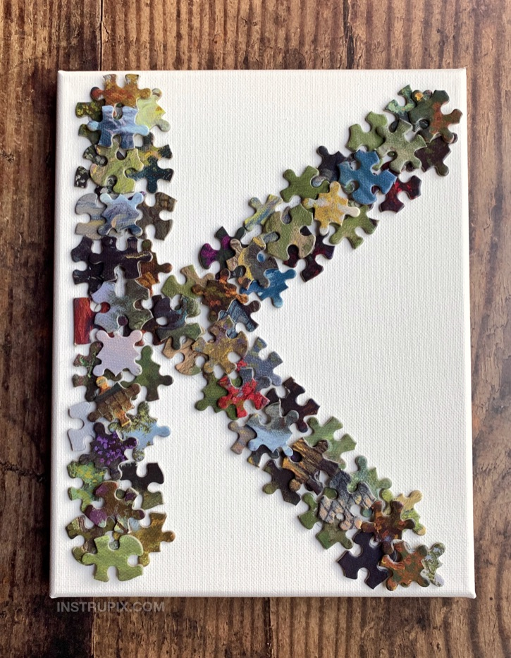 Easy DIY Wall Decor Idea using puzzle pieces! Glue puzzle pieces onto a canvas into the shape of letters. Awesome and cheap idea for teenagers to make for their room! Lots of other fun and easy puzzle piece craft ideas here, too.