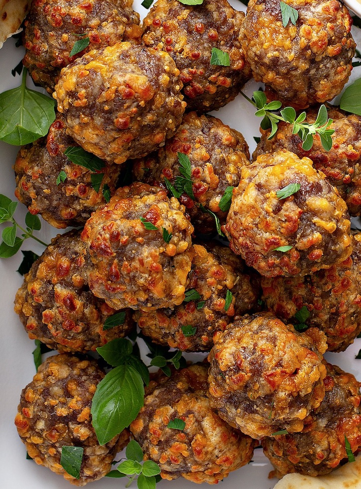 Cheesy Stuffing Sausage Balls -- The BEST holiday appetizer and finger food idea! Made with just 3 simple ingredients. Perfect for parties and family gatherings for Thanksgiving and Christmas.