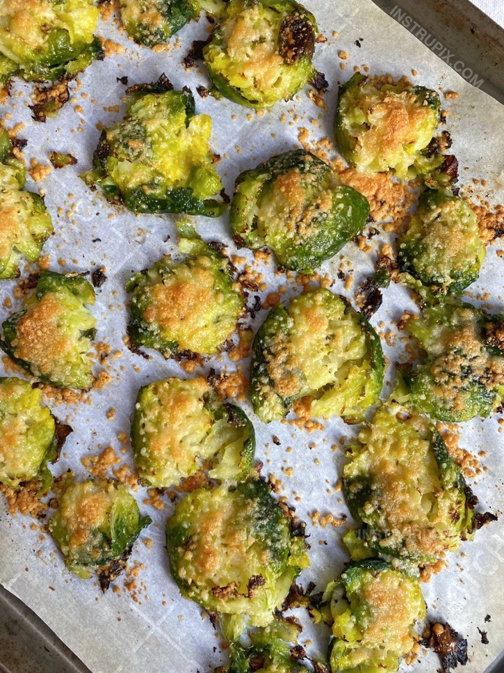 Smashed & Roasted Crispy Brussels Sprouts (made with garlic and parmesan cheese!). The BEST quick and easy veggie side dish for dinner. Great with chicken, steak, fish, bbq and more!