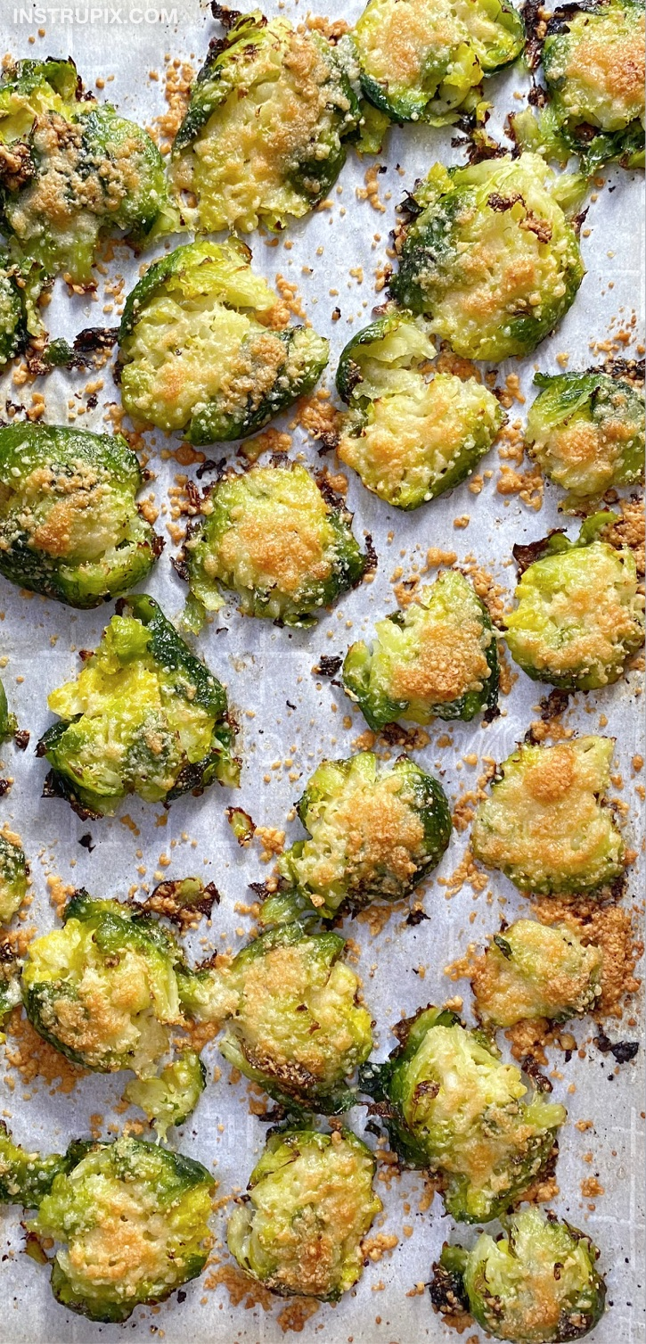 Smashed & Roasted Brussels Sprouts - The BEST veggie side dish recipe for dinner! A family favorite served with chicken and steak. These oven baked brussels sprouts are healthy, low carb, keto and vegetarian! Simple to make with olive oil, parmesan cheese and garlic. They turn out so crispy!