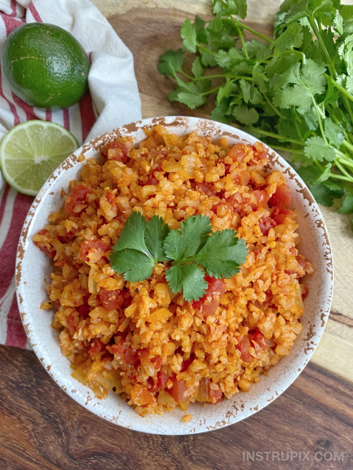 Easy Spanish Cauliflower Rice Recipe (made with frozen cauliflower rice!) So simple, healthy and yummy. This low carb side dish recipe pairs really well with any Mexican inspired dinner, and is quick to throw together for busy weeknight meals.
