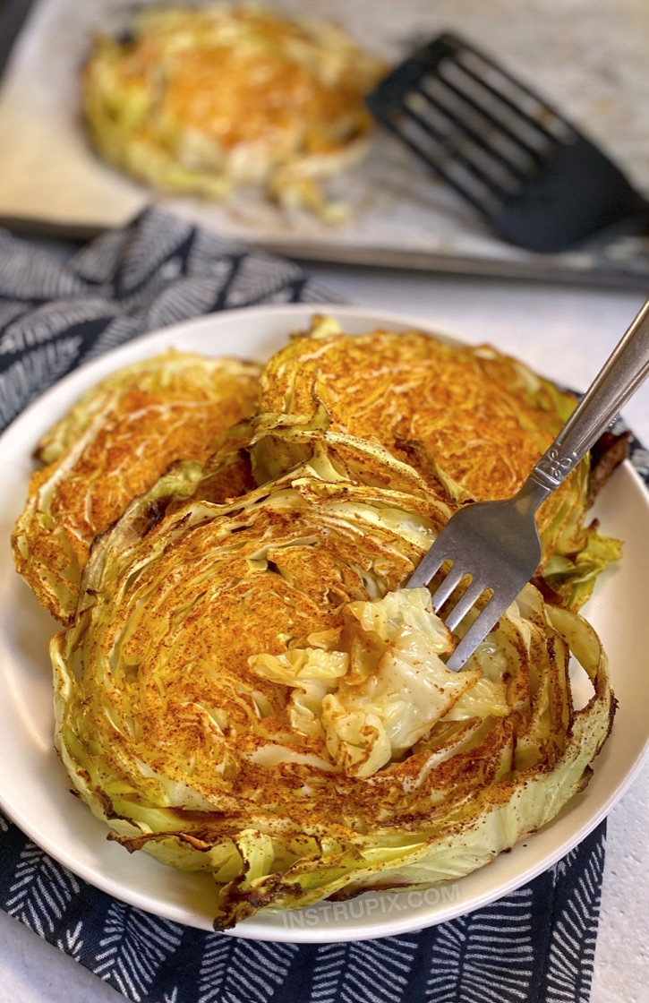 Oven Baked Roasted Cabbage Steaks (Healthy, Low Carb, Keto, Vegan & Super Easy To Make) My favorite veggie side dish for dinner! These cabbage steaks are made with just a few simple ingredients including olive oil, garlic powder and paprika. A family favorite! Serve them alone or with chicken, steak or seafood.